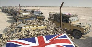 Union flag-bedecked Land Rovers of the Black Watch regiment stand ready for deployment