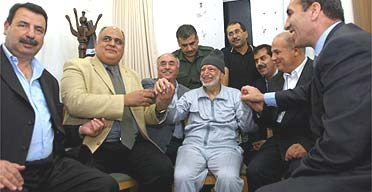 A picture provided by Palestinian Authority shows leader Yasser Arafat surrounded by his doctors