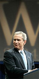 George Bush smiles as he delivers his victory speech during an event in Washington