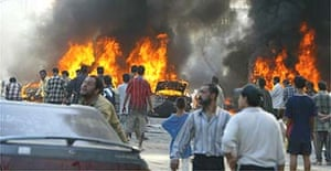 Vehicles burn following a car bomb in the centre of Baghdad