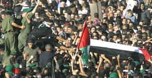 Arafat's coffin carried away