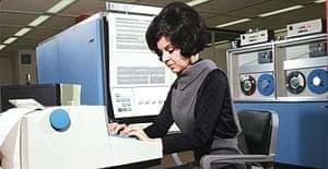 Operator using a 1960s IBM computer