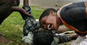 Parents mourn their son after the tsunami in Cuddalore, south India