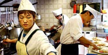 Korean staff in the kitchen of the Asadal in New Malden