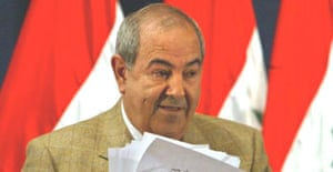 The Iraqi prime minister, Ayad Allawi, gathers his papers after briefing reporters in Baghdad. Photograph: Chris Helgren/AP
