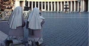 Two nuns pray in St Peter's square