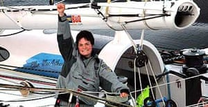 Ellen MacArthur celebrates breaking the record to sail solo, non-stop around the world