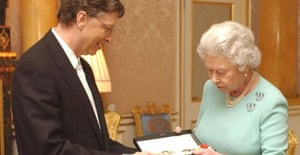 The Queen presents Bill Gates with his honorary knighthood at Buckingham Palace. Photograph: Chris Young/AP