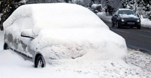 An abandoned car covered in snow near Challock, Kent. Commuters face travel chaos after heavy snowfalls