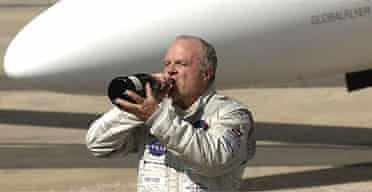 Steve Fossett celebrates after becoming the first to fly solo around the world without refuelling