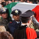 The coffin of late Italian intelligence officer Nicola Calipari is carried during his funeral in Rome