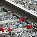 Flowers lie on the railway tracks at El Pozo station to mark the first anniversary of the Madrid train bombings