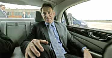 Tony Blair in his car at Teesside airport during a visit to Durham and Hull