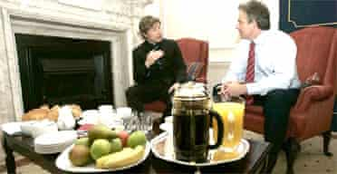 TV chef Jamie Oliver speaks to Tony Blair after delivering a petition to Downing Street demanding better food for pupils