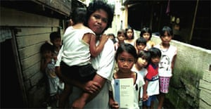 Angelina Teodoro, 38-year-old mother of four living in a slum area in Manila, Philippines