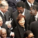 Prince Charles shakes hands with Robert Mugabe during Pope John Paul II's funeral