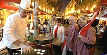 Lebanese women order pancakes in Beirut in a bid to revive central city nightlife after the assassination of former prime minister Rafiq Hariri