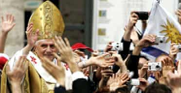 Pope Benedict XVI waves to pilgrims at the end of his inaugural mass. Photograph: Davide Santorelli/Getty