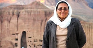 Habiba Sarobi, Afghanistan's first female governor. In the background is the site of Bamiyan's destroyed Buddhas