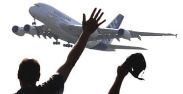 Spectators wave as they watch the world's biggest airliner, the Airbus A380, take off on its maiden flight at Toulouse-Blagnac airport in France. Photograph: Eric Gaillard/Reuters