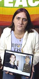 Rose Gentle holding a picture of her son Gordon, who was killed in Iraq