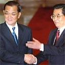 Taiwanese Nationalist party chairman, Lien Chan, left, shakes hands with Chinese president, Hu Jintao, in a historic meeting at the Great Hall of the People in Beijing, China
