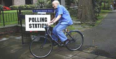 A voter heads off on a bicycle after casting his vote
