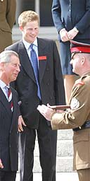 The Prince of Wales talks to Sergeant Major Vince Gaunt who will be responsible for Prince Harry  during his time at Sandhurst
