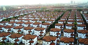 Rows of new houses illustrate the wealth - and uniformity - of Huaxi in China