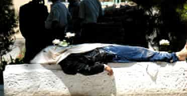 A corpse lays on slab in the centre of the Uzbek town of Andijan