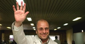Former Iranian police chief Mohammad Baqer Qalibaf waves as he arrives to register as a presidential candidate in Tehran. Photograph: Morteza Nikoubazl/Reuters