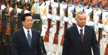 The Uzbek president, Islam Karimov (r) is accompanied by the Chinese premier, Hu Jintao, as he inspects a guard of honour outside the Great Hall of the People in Beijing. Photograph: Elizabeth Dalziel/AP