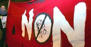 Leftist militants hold a banner reading