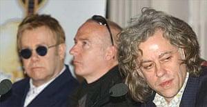 Sir Elton John, Midge Ure and Sir Bob Geldof during a press conference for Live 8