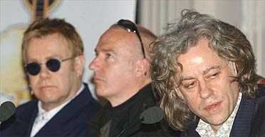 Sir Elton John, Midge Ure and Sir Bob Geldof during a press conference for Live 8