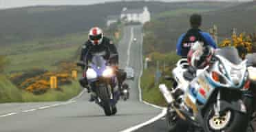 Riders head down to Creg Ny Baa on the TT course on the Isle of Man. Photograph: Don McPhee/Guardian