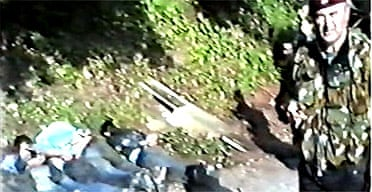 Video grab from footage shot near Srebrenica shown at the Hague war crimes tribunal on June 2 2005 showing men lying on the ground before being taken elsewhere where some of them were shot