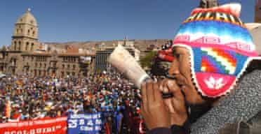 Bolivian indigenous leader Jaime Alanoca Mamani plays a traditional instrument as tens of thousands of people gather in La Paz for demonstrations that culminated in the resignation of the country's president, Carlos Mesa. Photograph: Dado Galdieri/AP