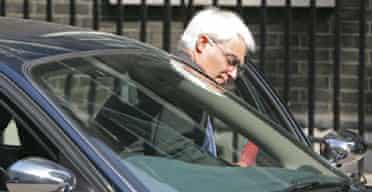 The transport secretary, Alistair Darling, leaves the press conference at which he unveiling proposals to alleviate traffic congestion. Photograph: Toby Melville/Reuters