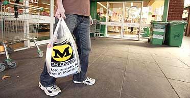 A shopper outside a Morrisons/Safeway supermarket