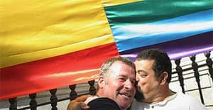 Spanish gay rights activists embrace after same-sex marriages were legalised