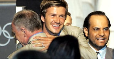 David Beckham hugs the London mayor, Ken Livingstone, following the announcement that London will host the 2012 Summer Olympic games