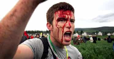 A demonstrator shouts at police during protests against the G8 summit in Auchterarder near the Gleneagles resort
