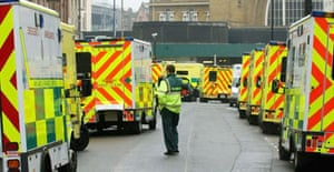 Ambulances stand at the ready in front of London's Kings Cross station following a series of explosions targeting the city's underground and bus services. Photograph: Martyn Hayhow/AFP/Getty Images