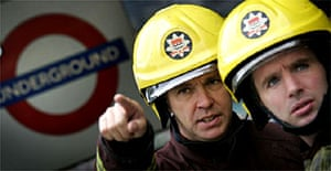 London fire brigade fire fighters prepare to enter the underground tunnel system at King's Cross station. Photograph: Kai Pfaffenbach/Reuters