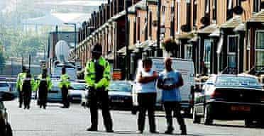Police guard a cordon in Beeston, Leeds