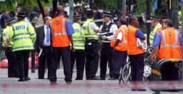 Police and emergency staff outside Stockwell underground station