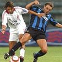 Inter Milan's Cristiano Zanetti (R) fights for the ball with AC Milan's Manuel Rui Costa