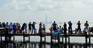 Spectators watch the launch of the space shuttle Discovery from the shore at Titusville Florida. Photograph: CJ Gunther/EPA