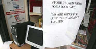 A closed sign greets shoppers to The Computer Shop outlet for Time and Tiny Computers in Glasgow